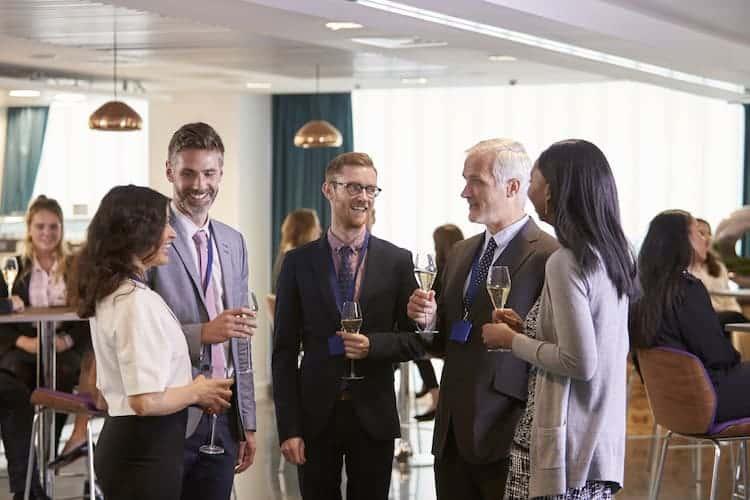 Working professionals at a networking event.