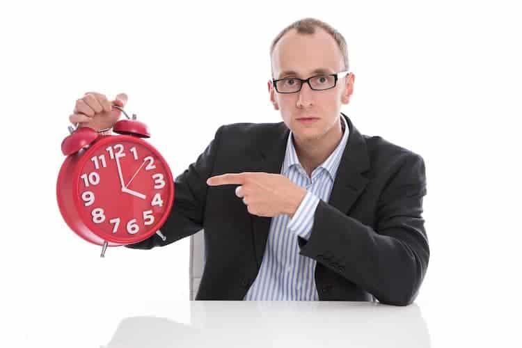 Man pointing at a clock