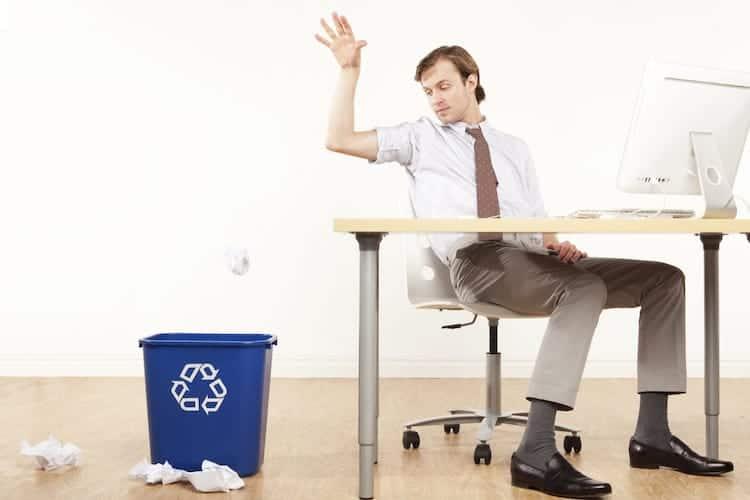 Man throwing away a resume